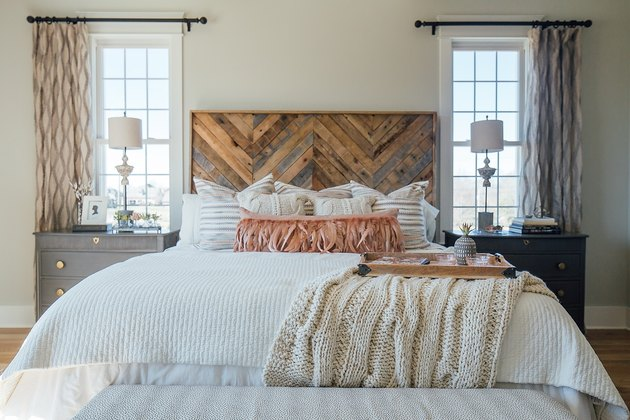 rustic bedroom headboard with luxury furnishings and rustic glam decor