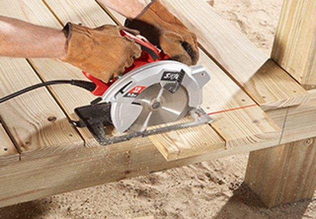 Circular saw cutting deck boards.