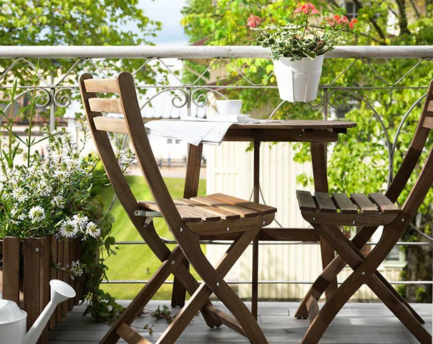 wooden chairs and table on balcony