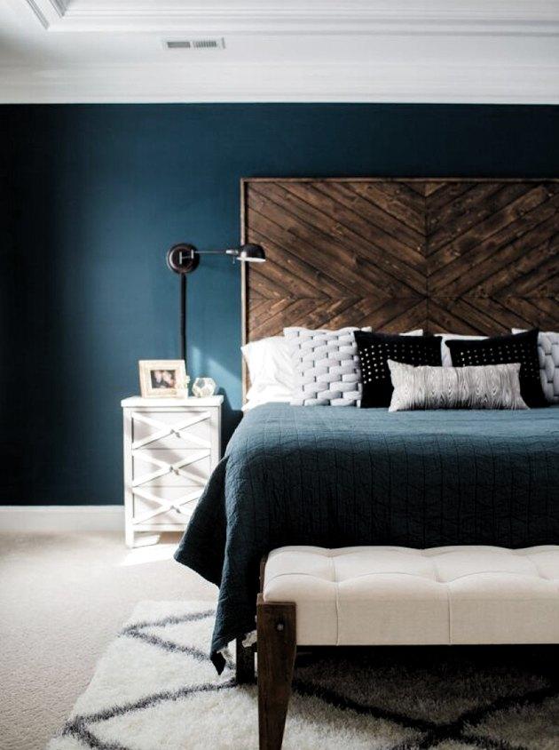 DIY rustic headboard in blue bedroom