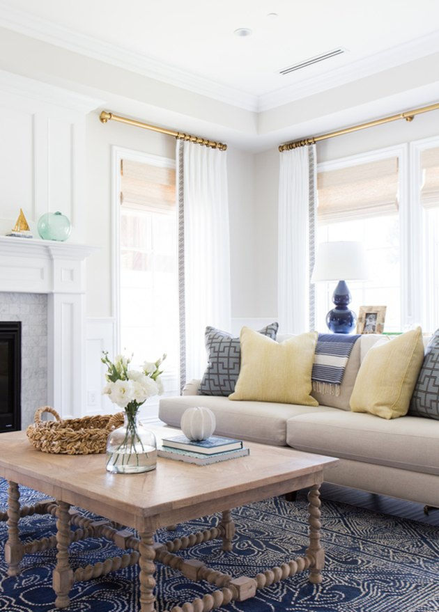 beige living room idea with yellow and blue accents by Studio McGee