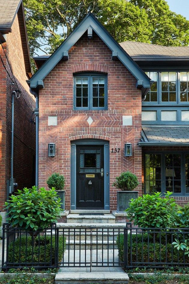 Traditional brick home with chevron patterning around front door