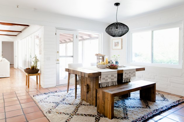 dining room decor idea with statement light fixture above wood table