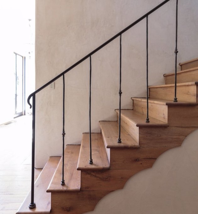 wood steps and riser with thin black stair railing