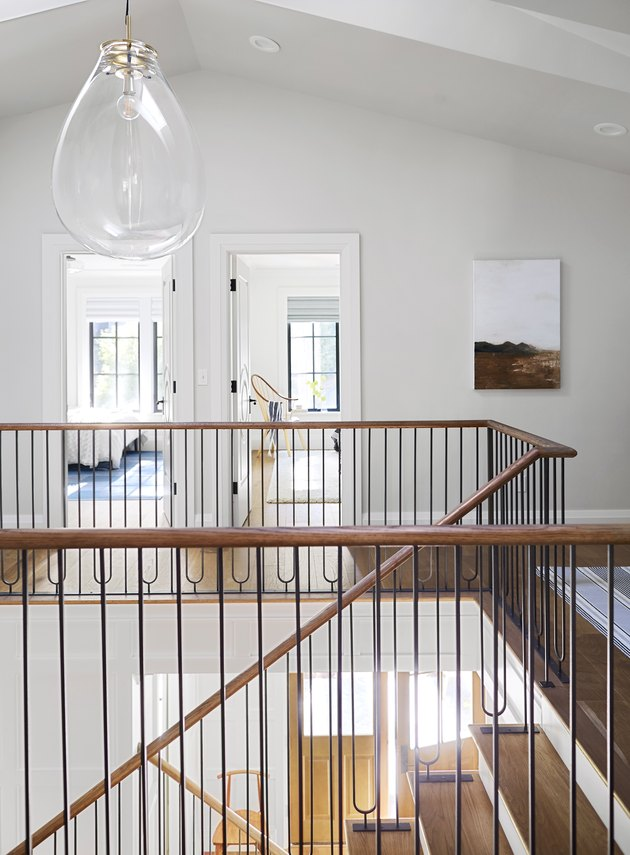 Modern staircase with glass pendant light