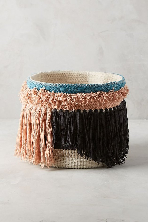 multicolored basket with tassels