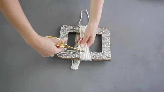 Cutting yarn off the picture frame