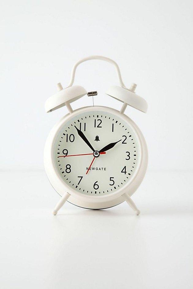 small off-white alarm clock