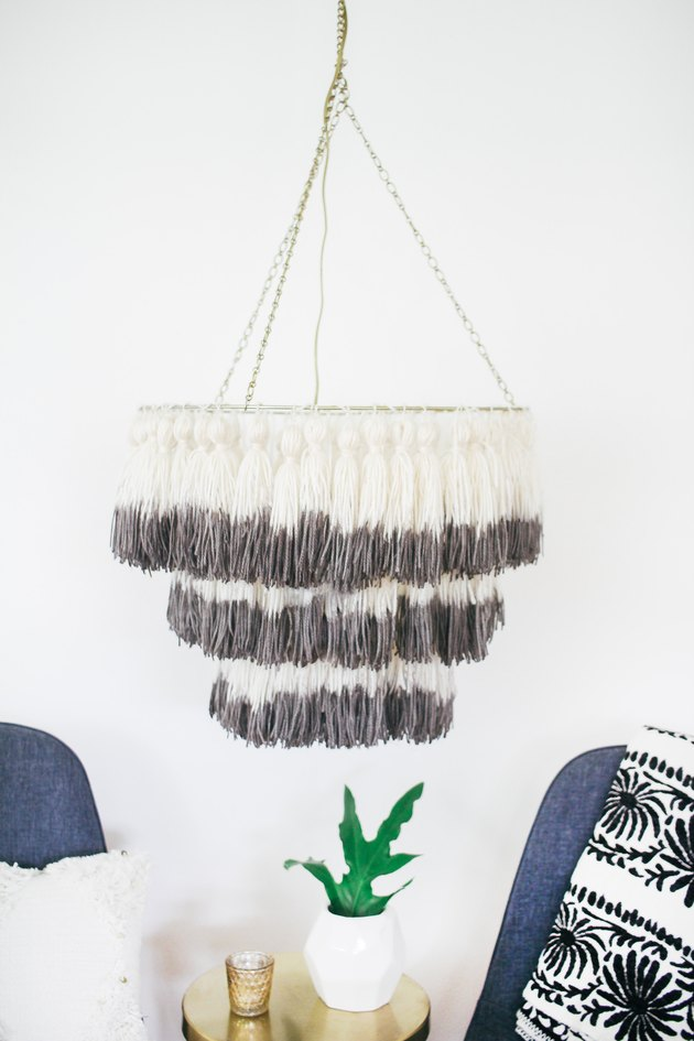 Dip-dyed tassel chandelier hanging from ceiling