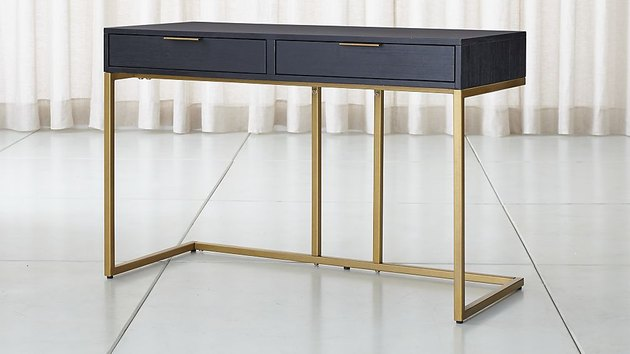 black desk with gold legs