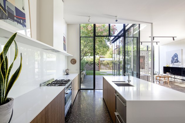 white contemporary kitchen with floor to ceiling windows