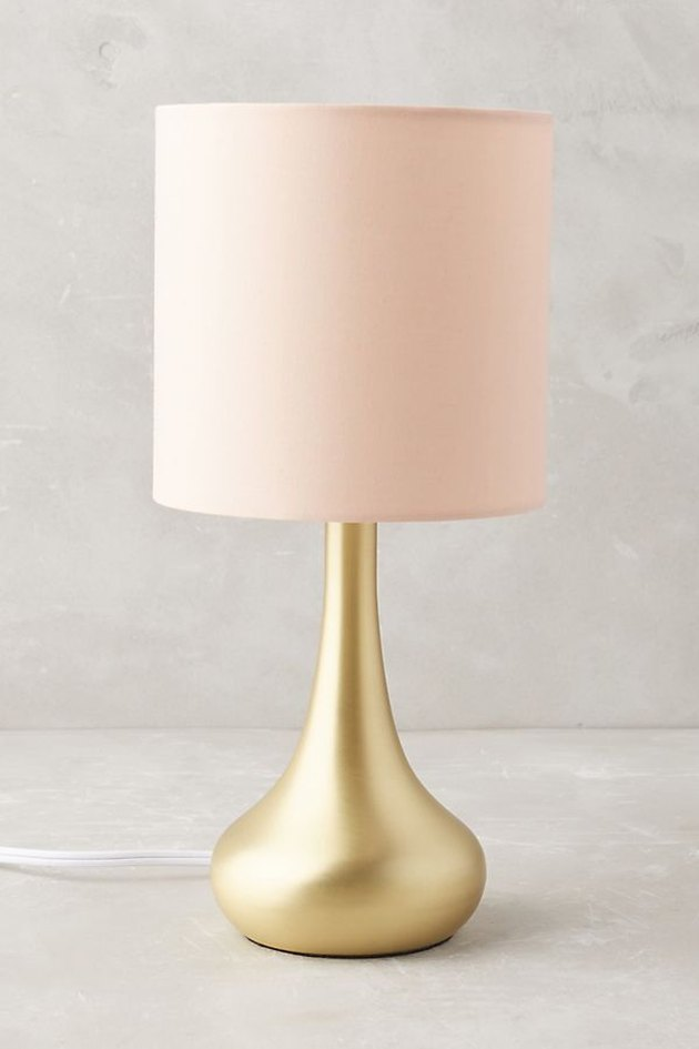 lamp with gold stand and pink lampshade