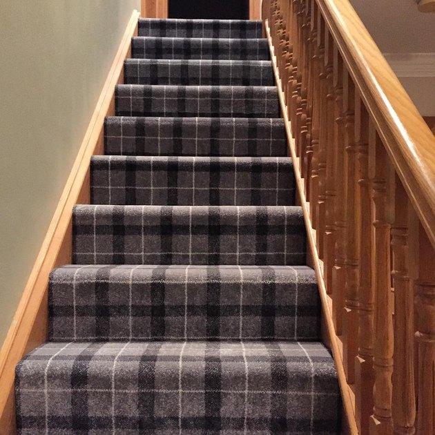 plaid stair carpet idea with wood railing