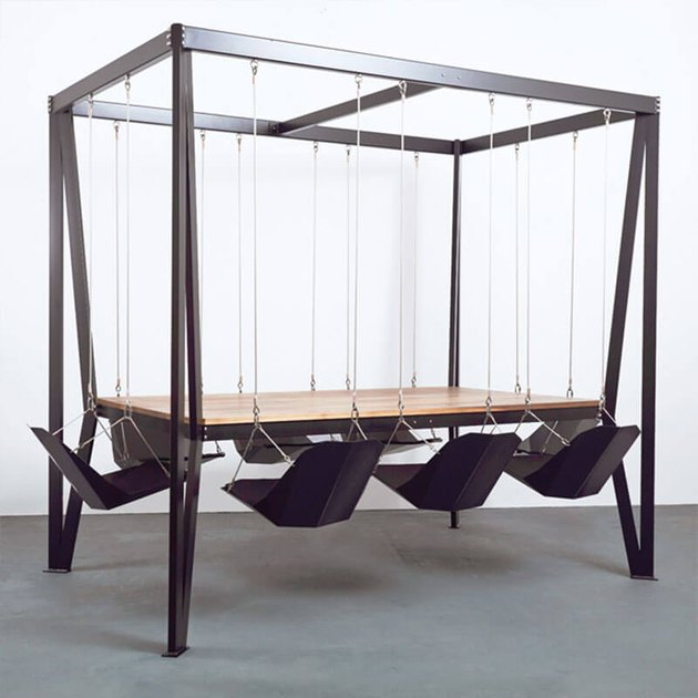 black swing table with swing chairs