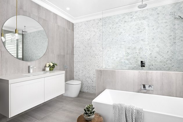 bathroom shower idea with a mosaic tile accent wall