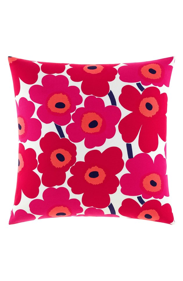 white and red floral pillow
