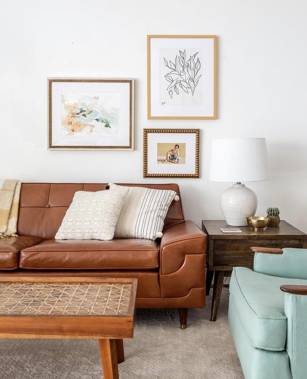 vintage living room idea with a brown fake leather couch and robin's egg blue armchair, both vintage