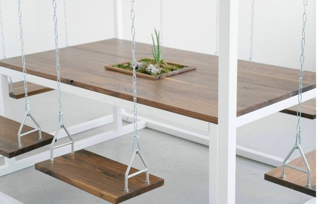 wood swing chairs around a swing table
