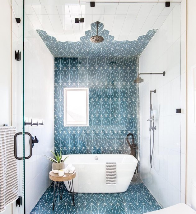 bathroom shower idea with freestanding bathtub and blue tile accent wall