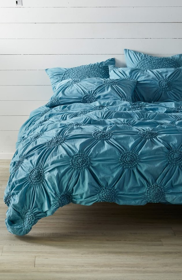 bed with blue duvet cover