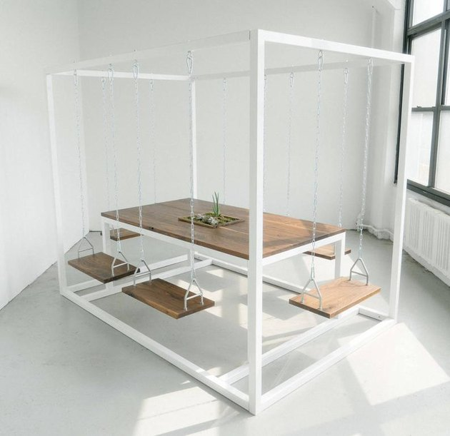 tall white swing table with swing chairs