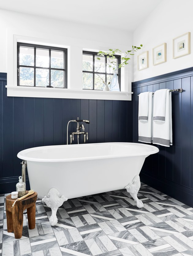bathroom floor tile idea with blue wainscoting and patterned tile with clawfoot tub