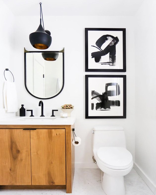 warm wood bathroom vanity idea in black and white bathroom