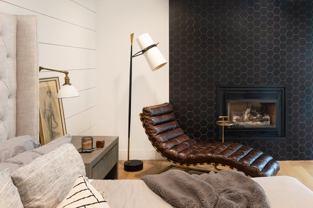 Cozy bedroom with black fireplace