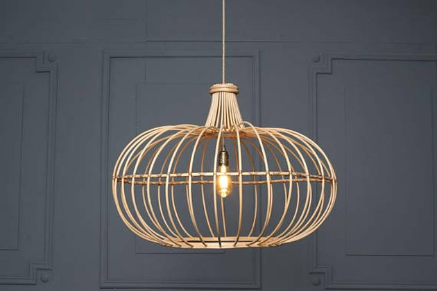 Wooden loosly slatted pendant light in compressed dome shape