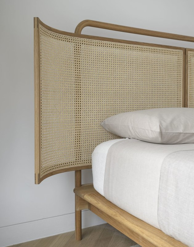Bed with natural cane headboard