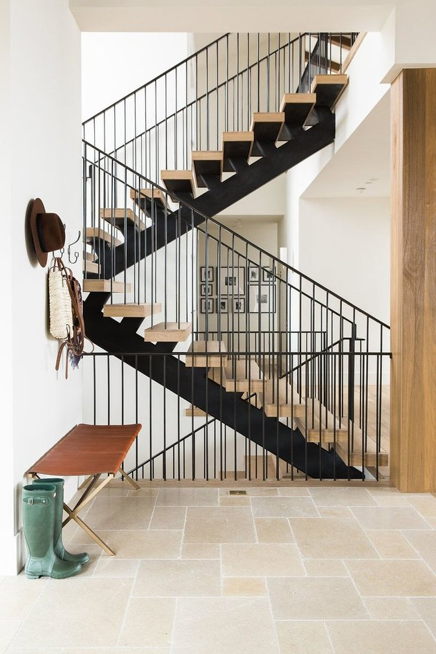 three-story modern black stair railing