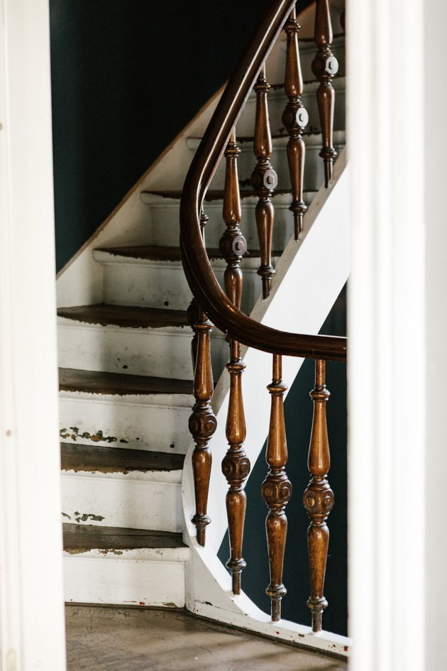 Rustic stair railing with curved banister and white steps