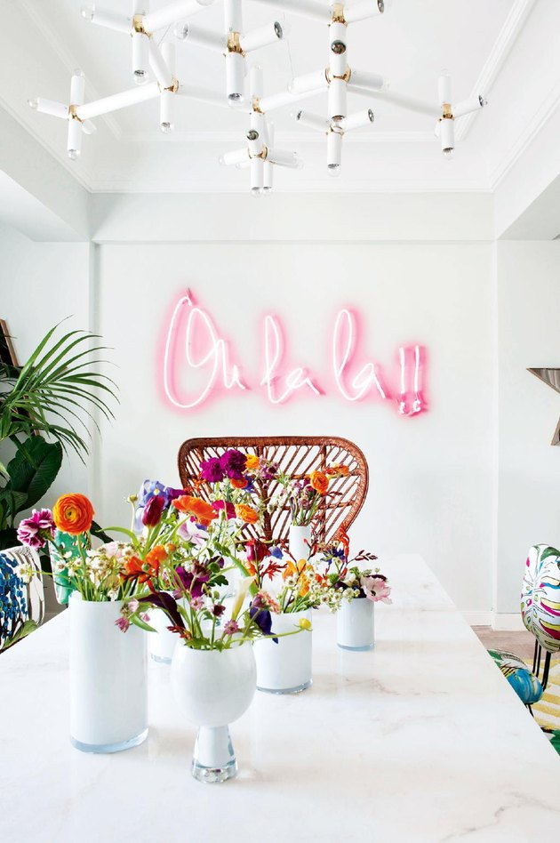neon sign in bohemian dining room