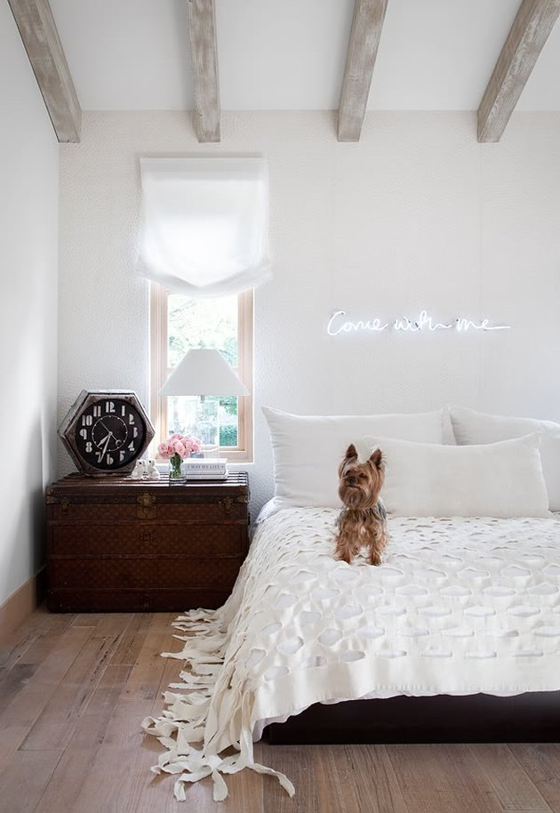 neon sign in rustic white bedroom