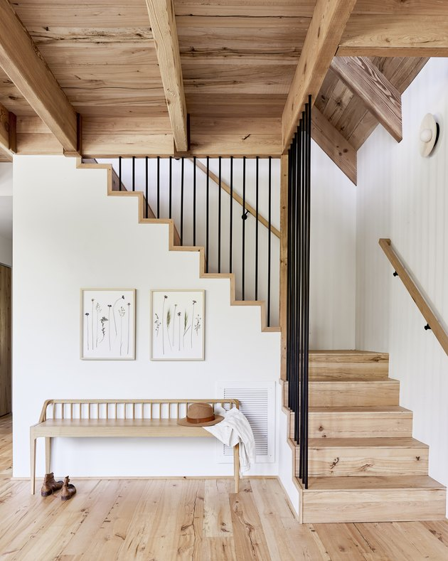 modern rustic stair railing with natural wood stairs and white walls
