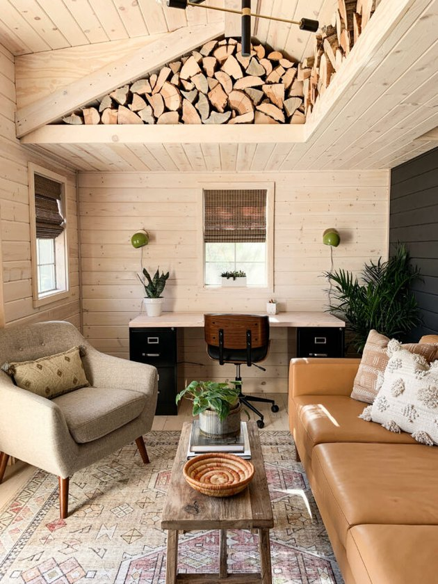 Rustic office with logs tucked into ceiling and wood plank walls