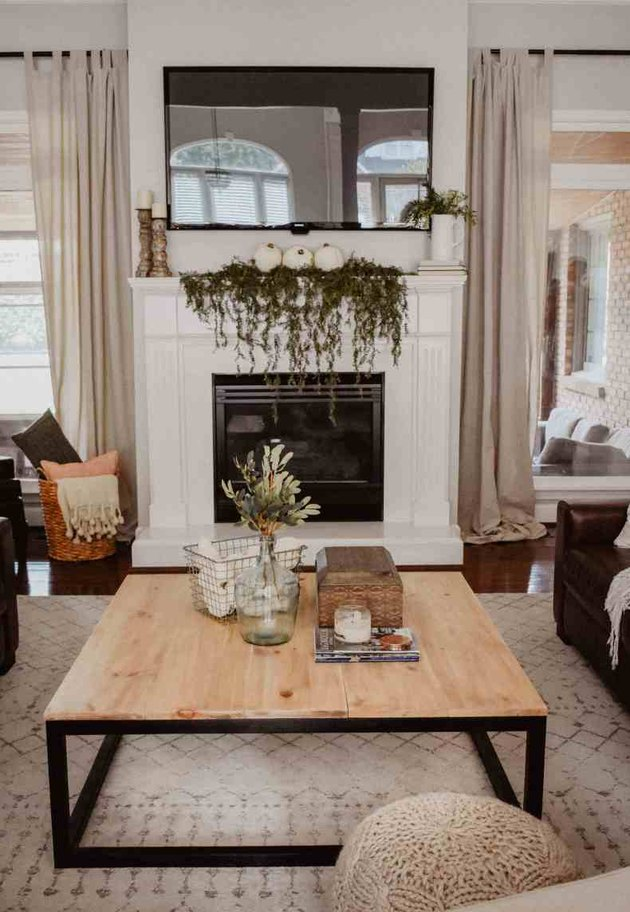 DIY rustic coffee table with black industrial legs in farmhouse living room