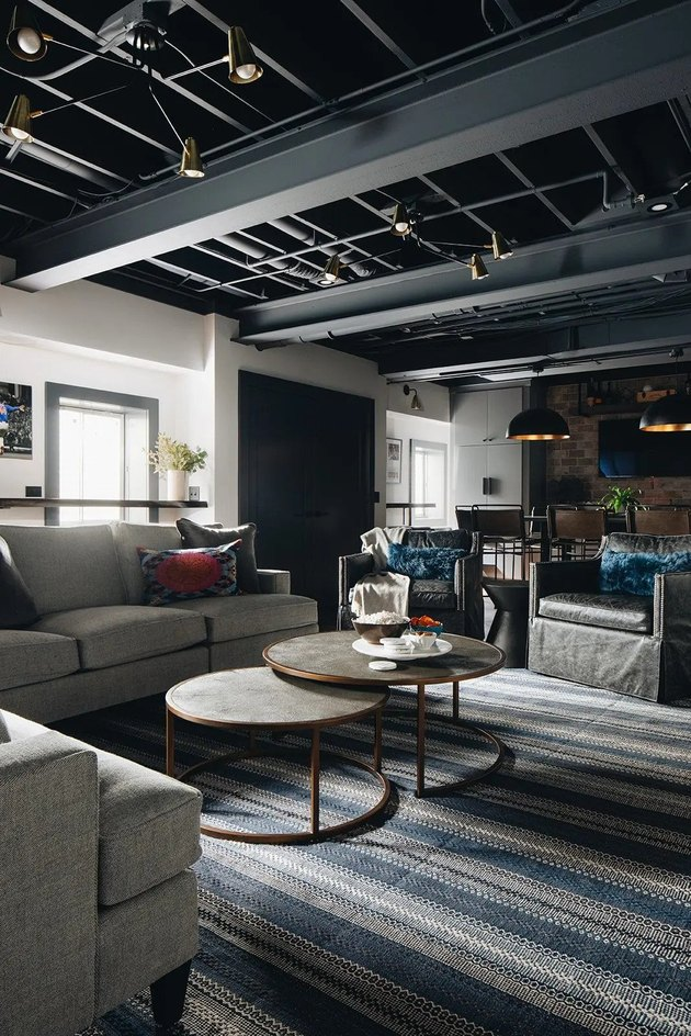 rustic man cave ideas with striped rug and two coffee tables