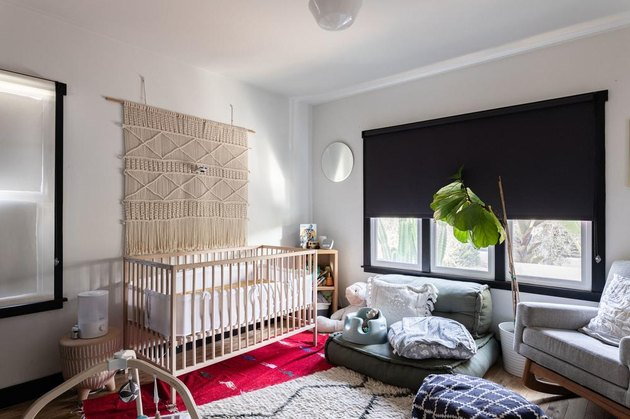 blackout blinds window treatments in white nursery with macrame wall hanging