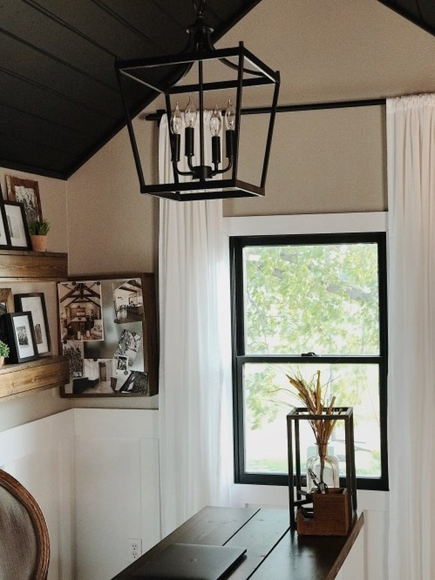 Rustic office with lantern pendant light and family photos