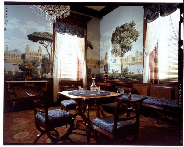 parlor room with natural landscape wallpaper