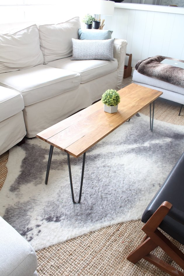DIY rustic coffee table with hairpin legs and wood tabletop in modern living room