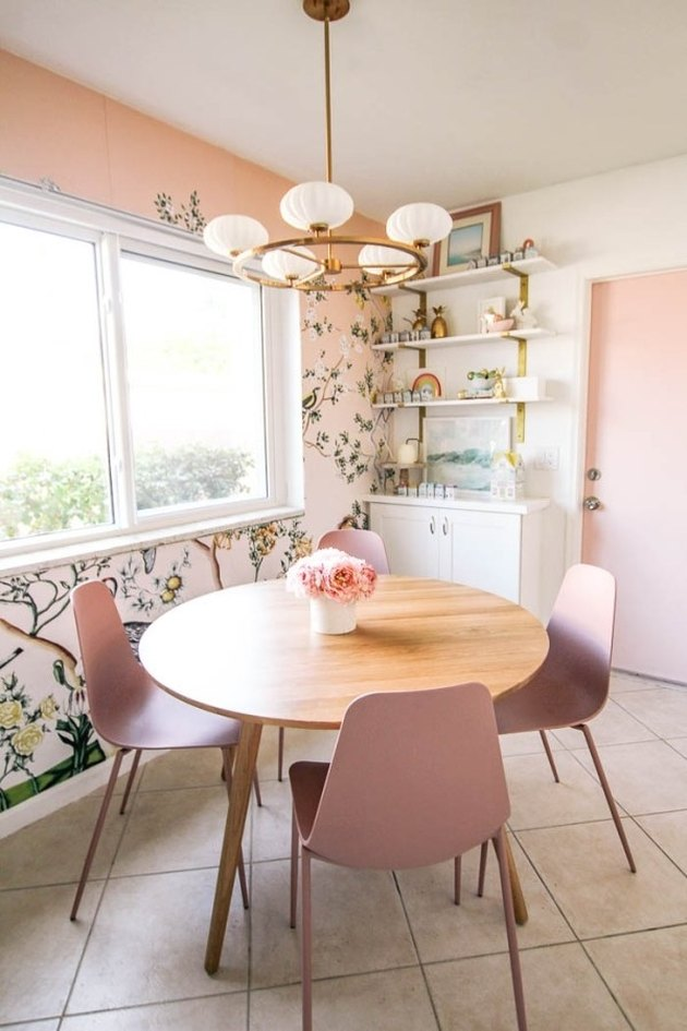 pink dining room with botanical wallpaper print and blush chairs