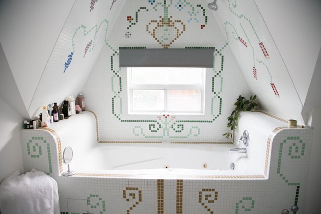 whirlpool tub surrounded by decorative, colorful tile