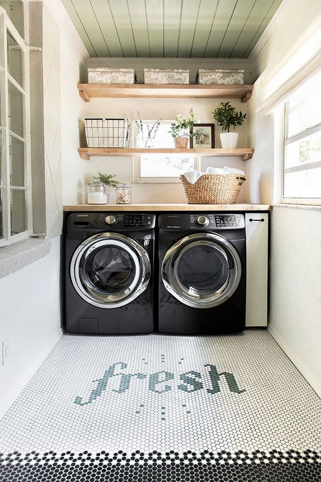 laundry room with washer and dryer with window plant shelves