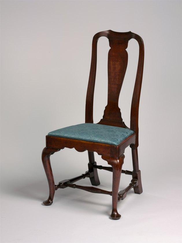 wood chair with green cushion