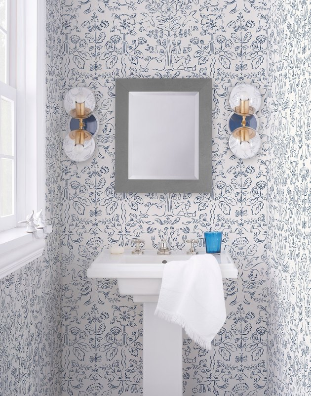 bathroom with blue and white wallpaper
