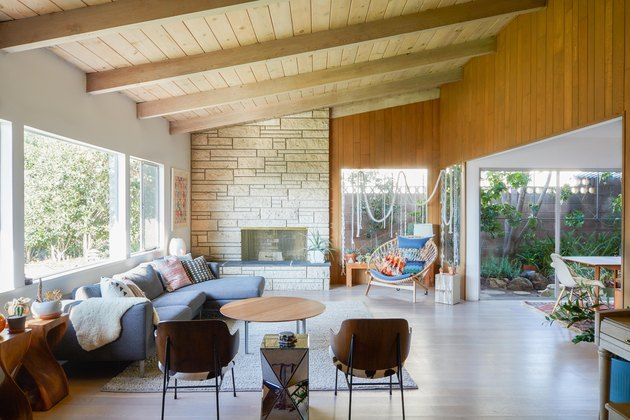 midcentury living room with wood paneling and light wood flooring