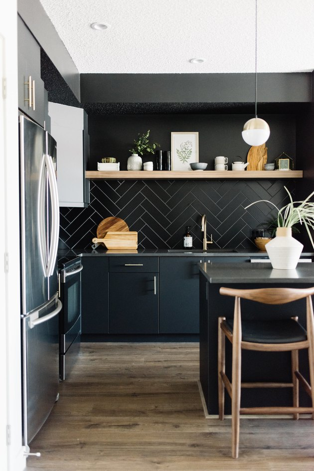Modern kitchen idea with black herringbone backsplash