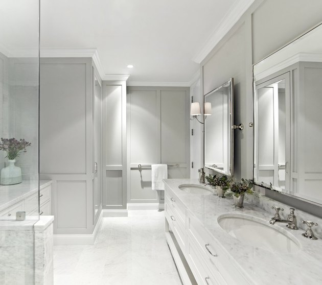 gray paint colors in bathroom with marble sink and wall paneling